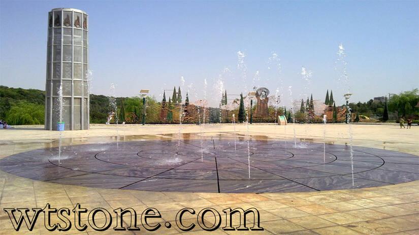 استفاده از سنگ گندمک تیشه ای در آب نمای پارک آب و آتش